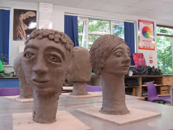 sculptured heads in clay