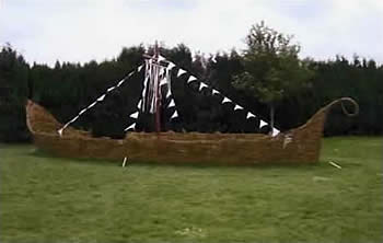 photos of a life sized viking ship and hut made from willow